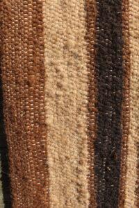 rug brown fawn black closeup